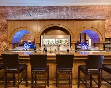 The main bar serves as a beautiful focal point at this speakeasy-style wine bar.