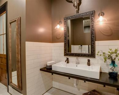 An elegant, traditional-styled restroom in a wine bar.