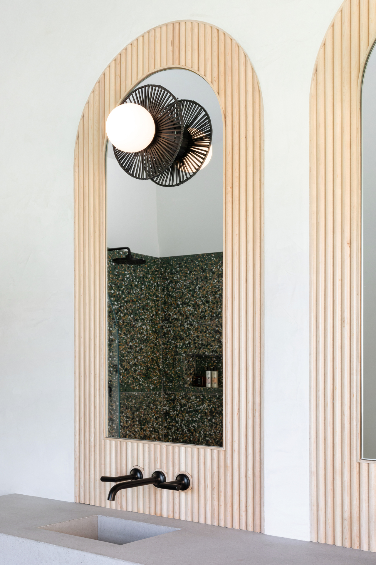 Beautiful solid wood tambour panels accent this bathroom mirror. Take restroom design to the next level with solid wood tambour panels from surfacing solution.