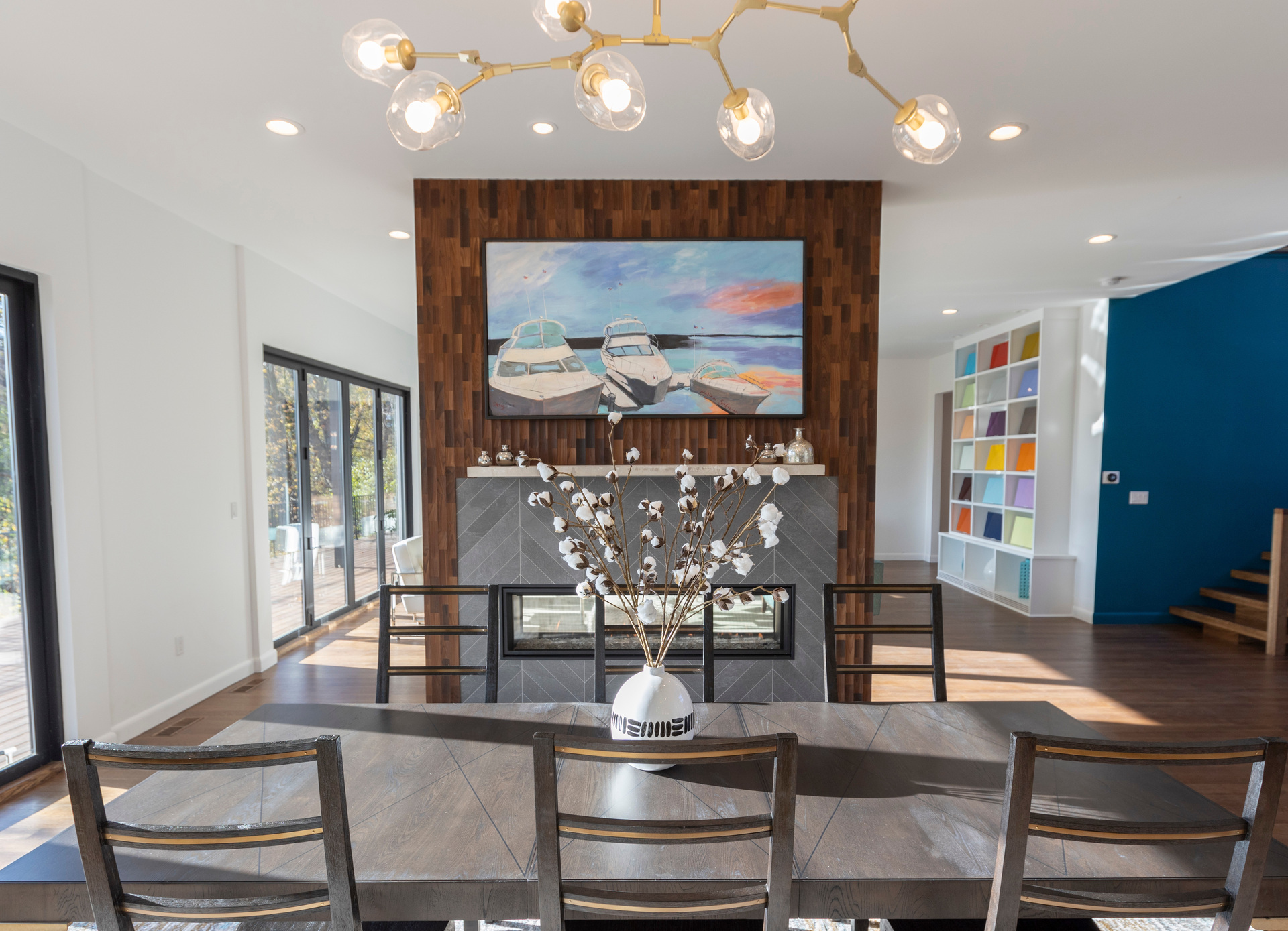 Wood Accent wall in this private residence is perfect for the fireplace partition wall.