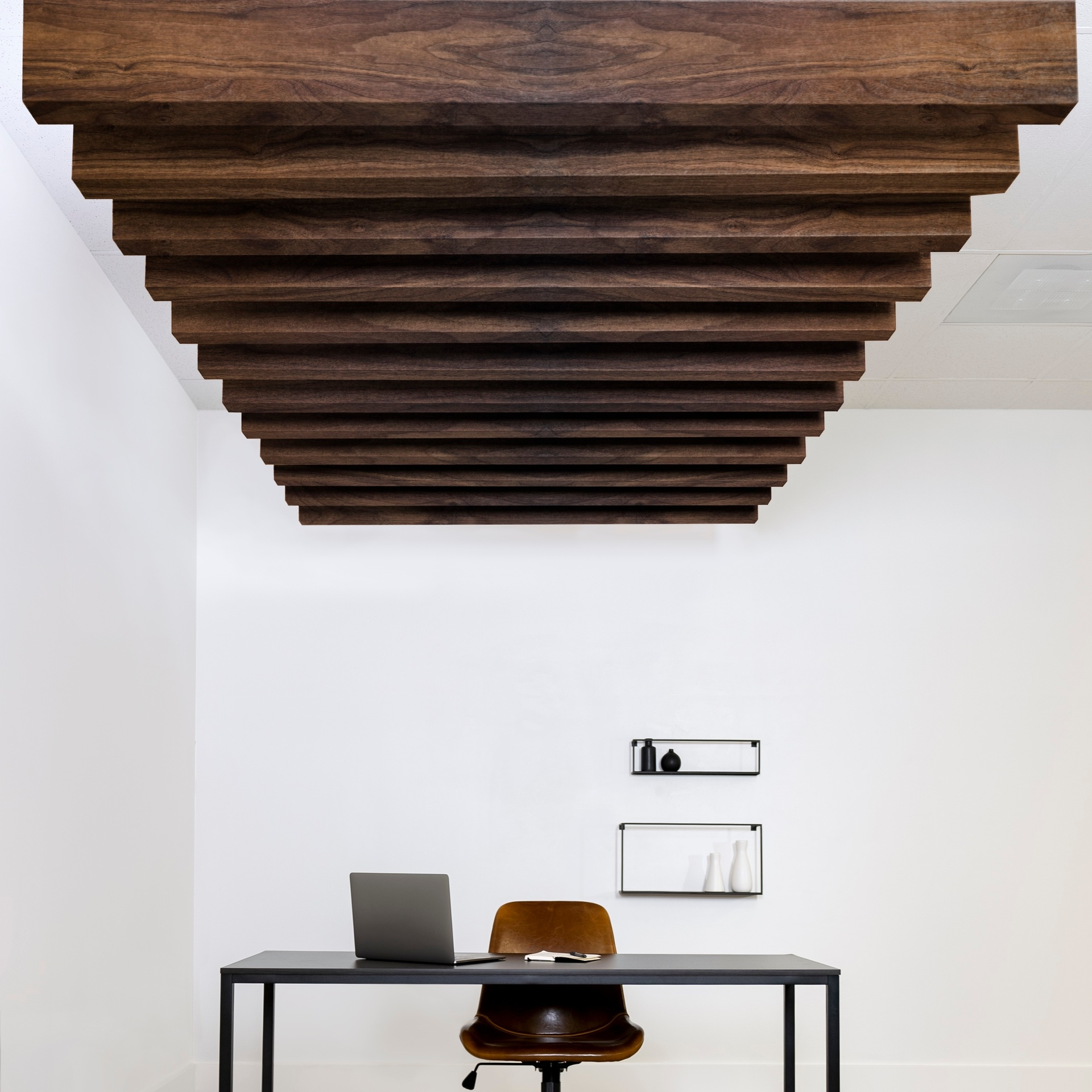 The Joist acoustic ceiling baffle is shown here in the dark walnut grain finish. This finish adds warmth to any space, while also providing sound absorption.