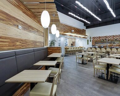 Two different wood grain and stain colors create a beautiful accent wall in this restaurant.