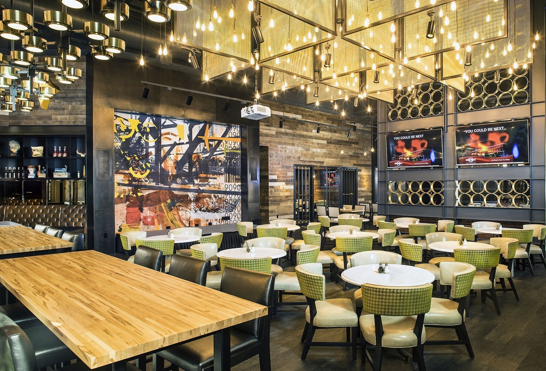 Featured in the 90-Ninteys Bar and Grill at the Suncoat Hotel and Casino are Butcher Block Tables in Ambrosia Maple by Wood Statements. Wood Statements custom butcher block tables offer a variety of options including matte or satin FDA approved finish that is heat, scratch, and moisture resistant.