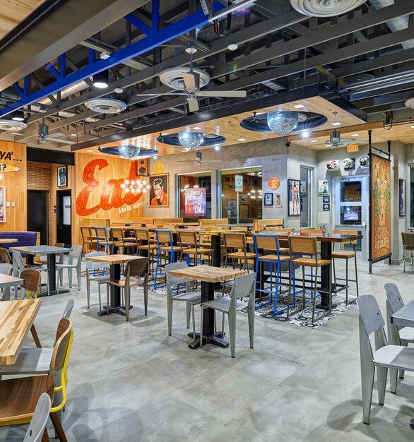 Wood Statements Ambrosia Maple Butcher Block tables can be found throughout many the rebranded Raising Cane's across the country. The lively interior rebrand included big pops of color and features local high school and college teams.