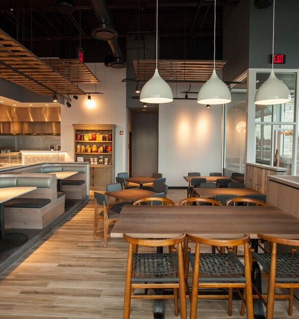 Wood Statements crafted custom stained wire-brushed white oak tables for the Roti Mediterranean Restaurant in Northbrook, Illinois.