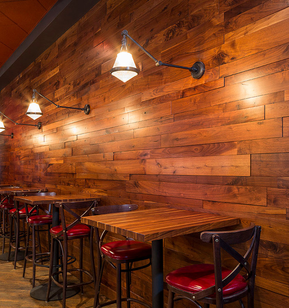 Wood Statements supplied walnut random width, depth, and length paneling, along with walnut butcher block tables for LaBarra in Oak Brook, Illinois.