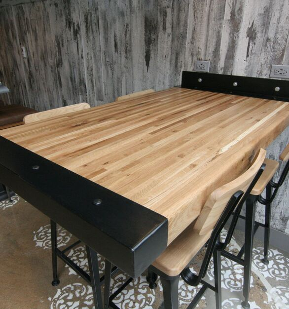 Stunning White Oak Butcher Block tables with custom metal end caps and cantilever crafted by Wood Statements for the Renaissance Hotel in downtown Chicago, Illinois.