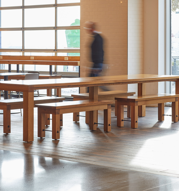 White oak plank 14' communal tables by Wood Statements is featured in the Navy Pier Family Pavillion Food Hall in Chicago, Illinois. The tables also feature custom white oak benches.