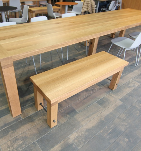 White oak plank 14' communal tables with custom white oak benches.