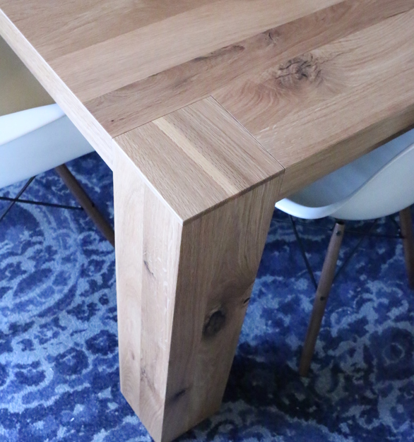 Close up view of Wood Statements White oak plank 14' communal table.