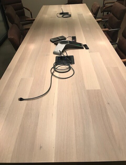 Custom white oak plank conference table with power crafted by Wood Statements