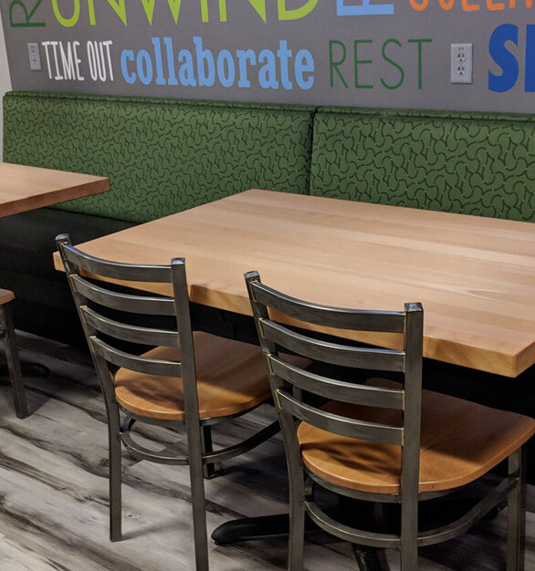 Solid Metal Chairs works great in this industrial style work break room.  Don't forget the solid Beech table top to complete this dining room.  Plymold creates metal frame and wood seating for commercial needs. Our industrial seating is perfect for restaurants, bars, night clubs, corporate break rooms, convenience stores and more.