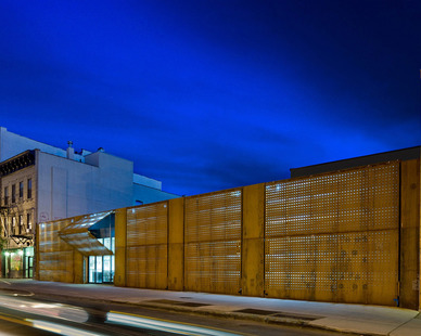 Andre Kikoski Architect designed a trademark façade is created with simple awning-style warehouse doors that are clad in double layers of weathered corten steel.
