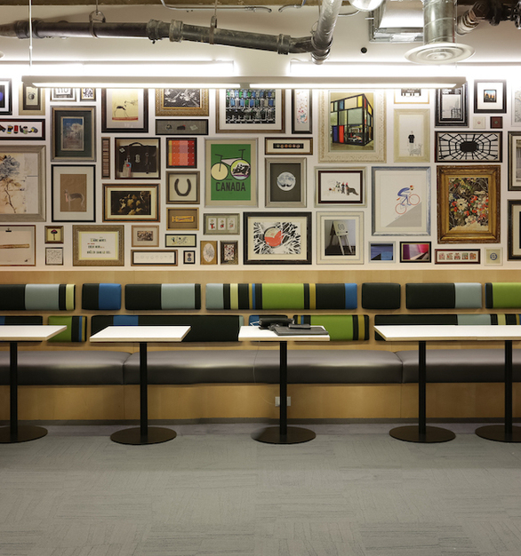 Yelp's Chicago office boasts a coffee shop on site for employees. The coffee shop features booth seating by Contract Industries.