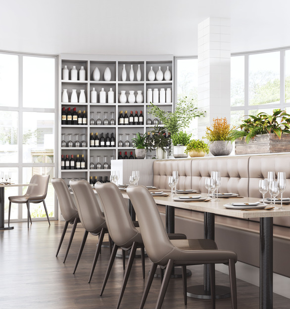 Zuo Modern chairs being featured in a dining room setting full of natural light and white accents