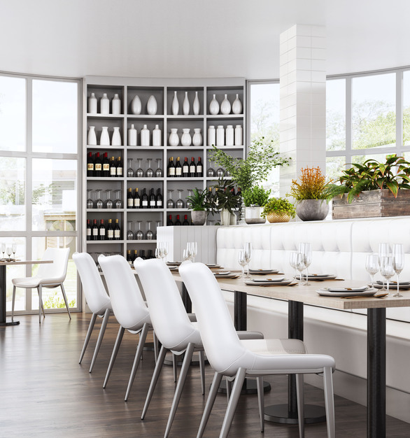 Clean bright dining area with Zuo Modern's  tables and chairs.