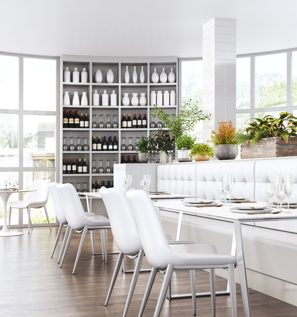 Zuo Modern's white chairs and stainless steel tables filling a naturally lit dining area.