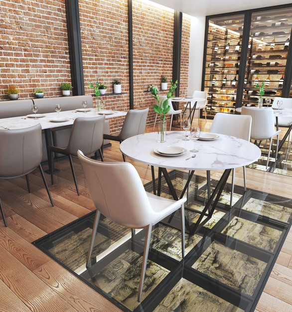 Indoor restaurant setting with Zuo Modern Magnus chairs.