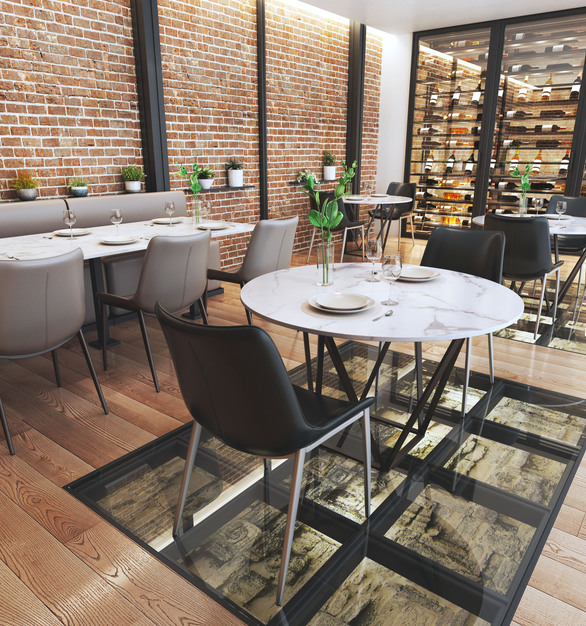 Magnus chairs by Zuo Modern in a dining space with natural and industrial views.