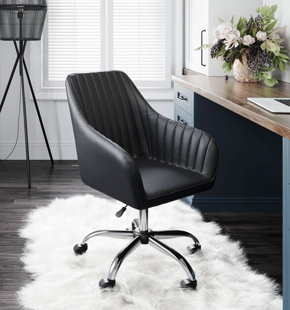 Wrapped in neutral-toned faux leather upholstery and elegantly accented with diamond tufts, this chair by ZUO Modern will make a statement in any space.