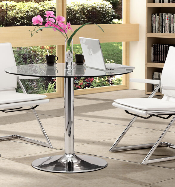 With its ergonomic shape, padded back, and seat cushions, the conference chair works in comfort by ZUO Modern.